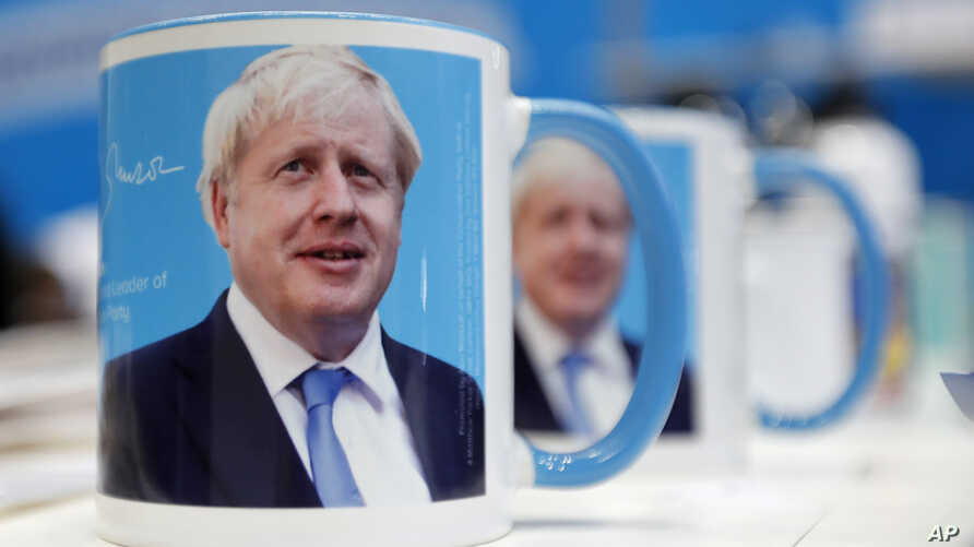 Mugs with a mug shot portrait of Boris Johnson are one sale at the annual Conservative Party Conference in Manchester, England, Sept. 29, 2019.