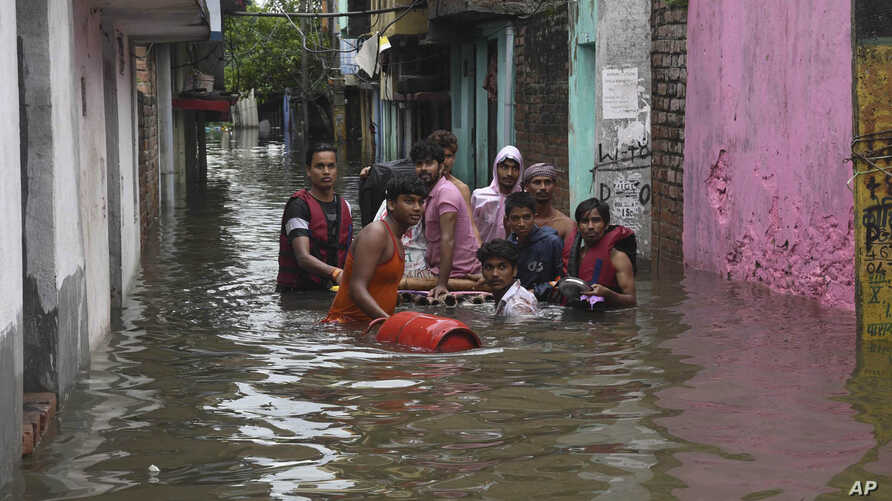 A sick person is rescued from a flooded area following heavy rainfall in Patna, India, Sept.30, 2019.