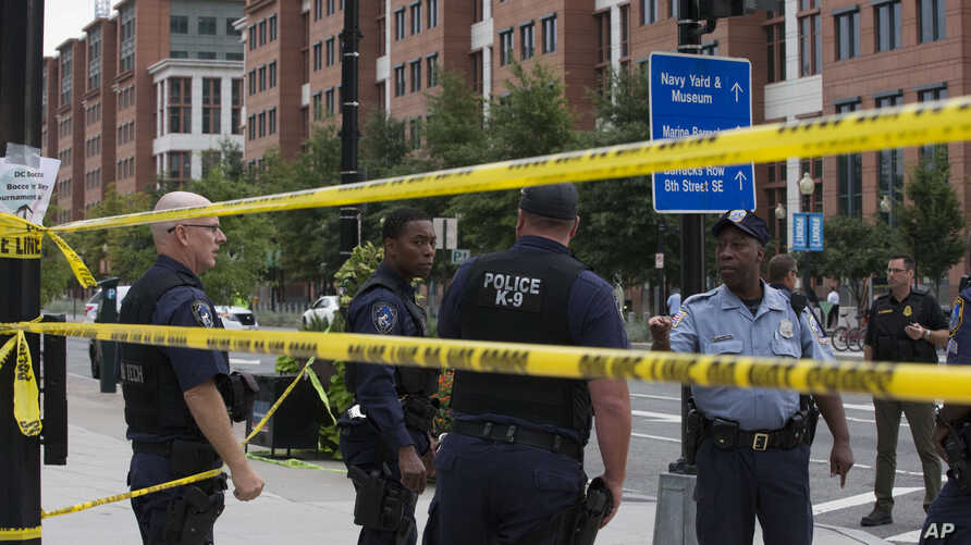 Police work the scene on M Street, SE in Washington near the Washington Navy Yard on Monday, Sept. 16, 2013.
