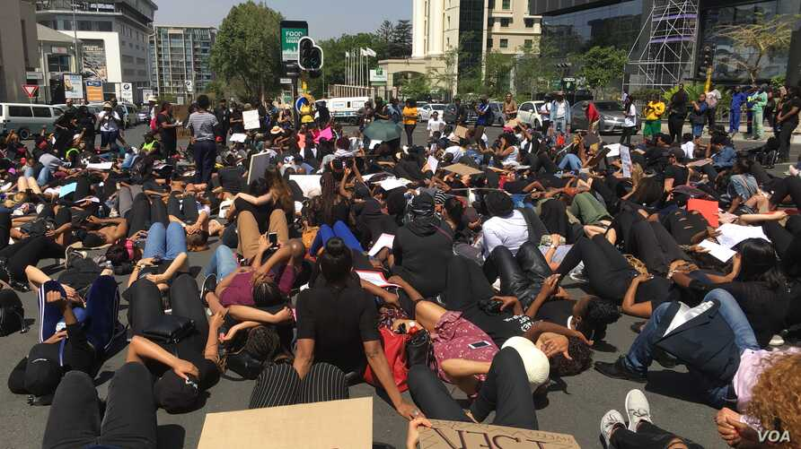 Women occupy a busy street intersection in Sandton, Johannesburg during a protest against gender based violence. (VOA/T. Khumalo)