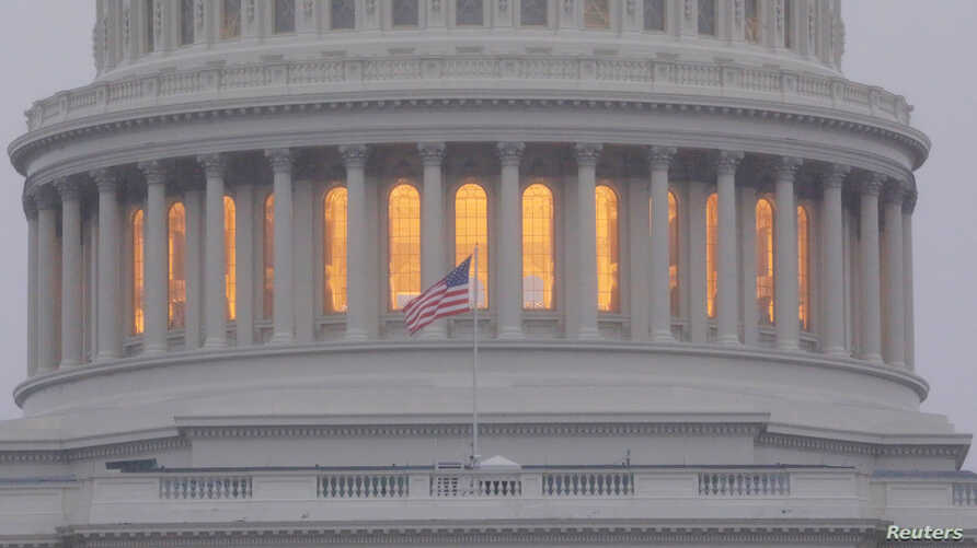 FILE - A United States flag flies in front of the U.S. Capitol dome in Washington, Nov. 6, 2018.