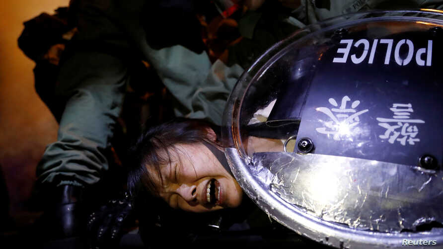 An anti-extradition bill protester is detained by riot police during a protest outside Mong Kok police station, in Hong Kong, China, Sept. 2, 2019.