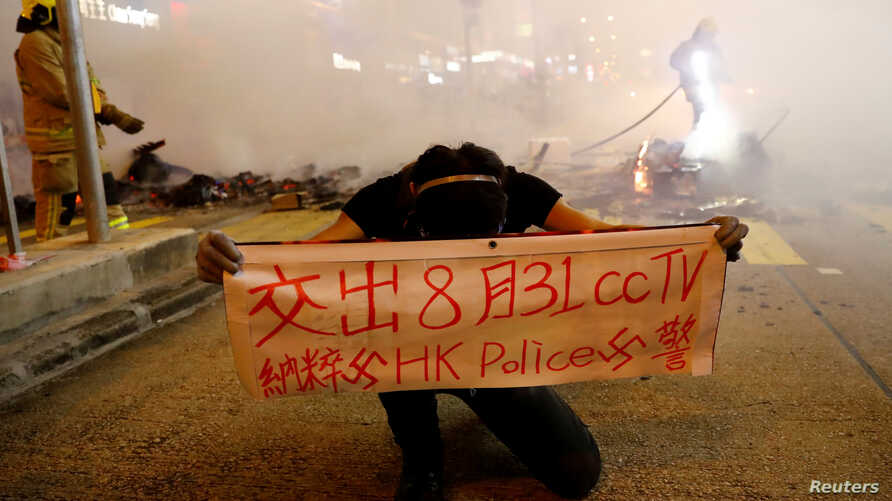 A protester holds a banner during a demonstration in Mong Kok district in Hong Kong, China, Sept. 6, 2019.