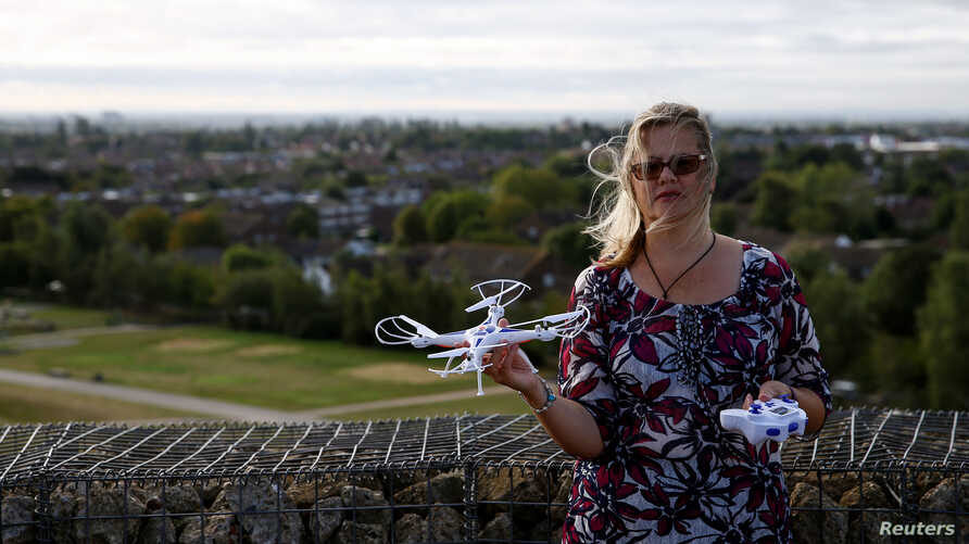 Activist Linda Davidsen poses with a drone near Heathrow Airport in London, Sept. 12, 2019.