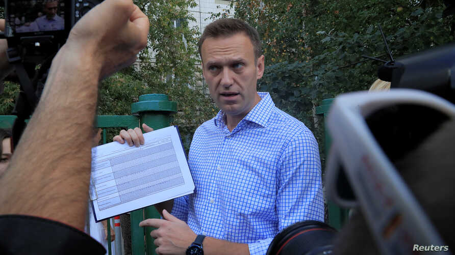 FILE - Russian opposition leader Alexei Navalny speaks with journalists in Moscow, Russia, Sept. 8, 2019.