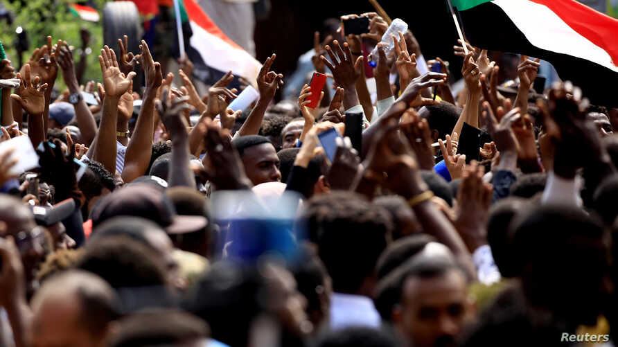 Sudanese demonstrators attend a protest calling for the appointment of top judicial officials and justice for killed demonstrators, outside the presidential palace in Khartoum in Khartoum, Sudan, Sept. 12, 2019.