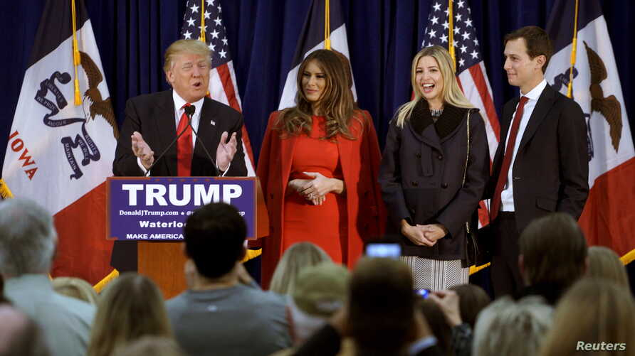 FILE - U.S. Republican presidential candidate Donald Trump speaks as, from left to right, his wife Melania, daughter Ivanka and Ivanka's husband Jared Kushner listen at a campaign rally on caucus day in Waterloo, Iowa, Feb. 1, 2016.