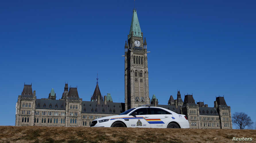 FILE - A Royal Canadian Mounted Police vehicle is seen on Parliament Hill in Ottawa, Ontario,  March 22, 2017.
