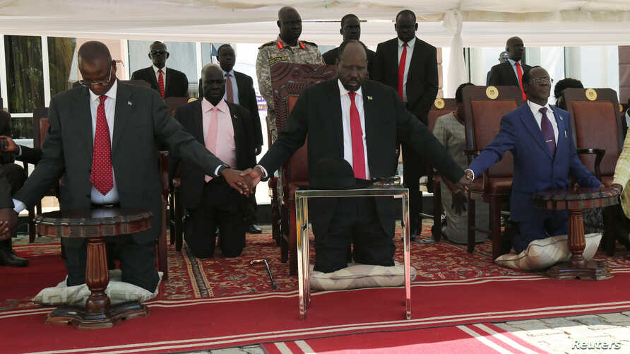 South Sudan's President Salva Kiir takes part in a national day of prayers for peace at the state house in Juba, South Sudan, Sept. 19, 2019.