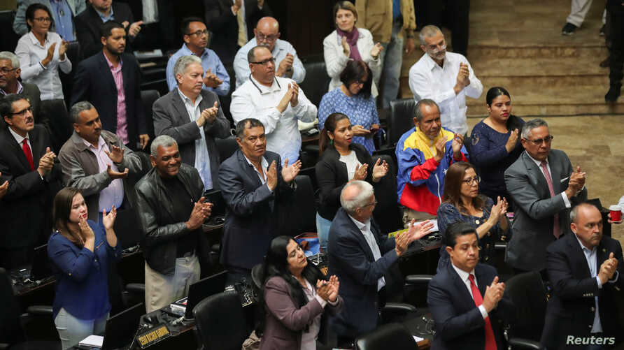 Pro-government lawmakers attend a session of Venezuela's National Assembly in Caracas, Sept. 24, 2019.