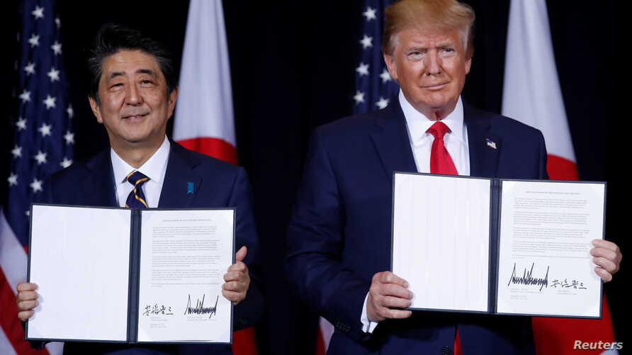 Japan's Prime Minister Shinzo Abe and U.S. President Donald Trump pose with a joint statement the two leaders made during a bilateral meeting on the sidelines of the 74th session of the United Nations General Assembly in New York City, Sept. 25, 2019.