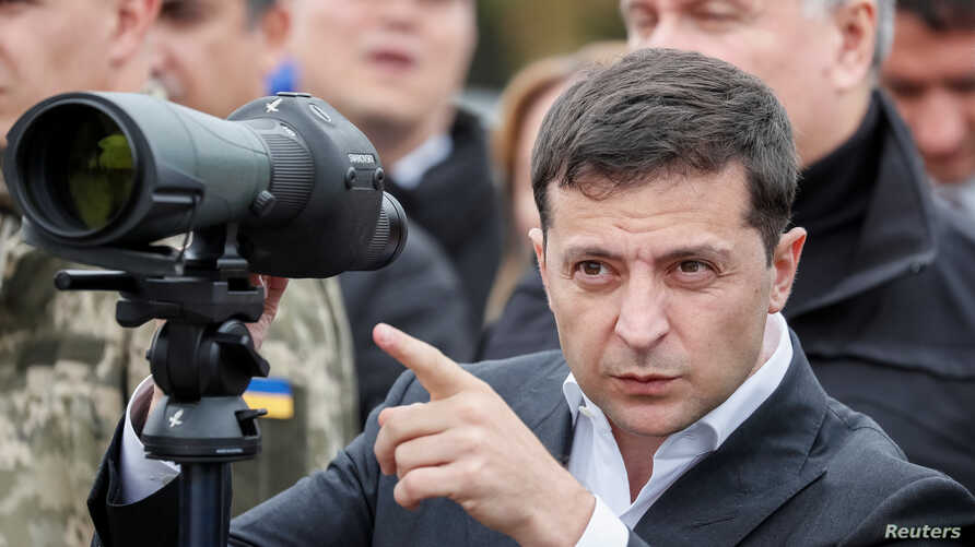 Ukrainian President Volodymyr Zelenskiy attends a joint drill of departments of Interior Ministry at the International training Centre near the village of Stare in Kyiv region, Ukraine, Sept. 30, 2019.