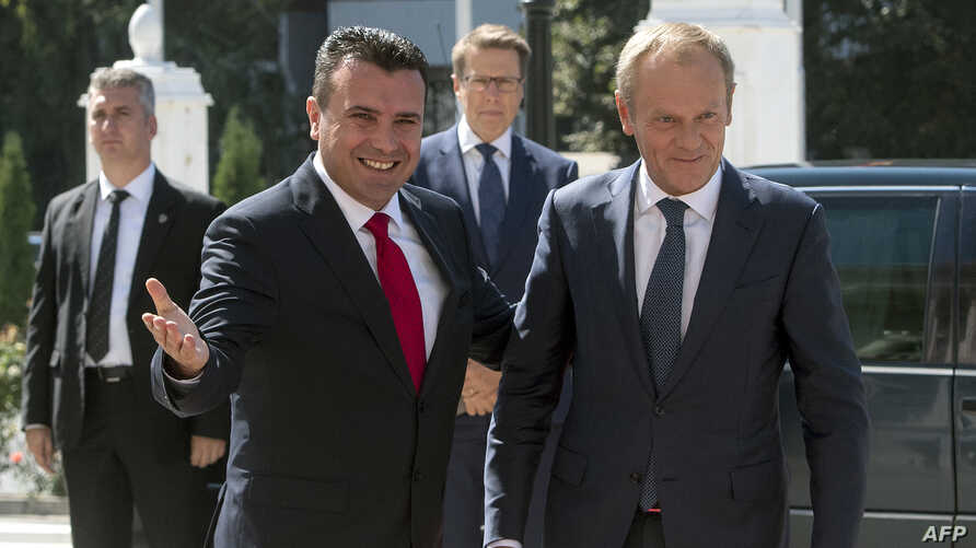 Macedonian Prime Minister Zoran Zaev (L) welcomes European Council President Donald Tusk upon his arrival in Skopje, Sept. 17, 2019.