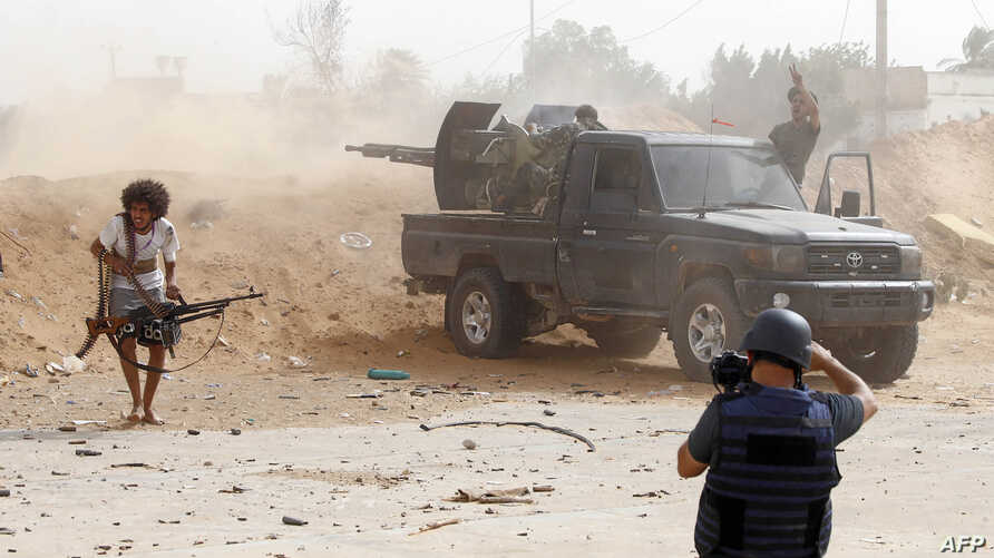 A journalist covers the frontline during clashes between forces loyal to strongman Khalifa Haftar and fighters loyal to the Libyan internationally-recognized Government of National Accord, south of Tripoli, May 25,2019.