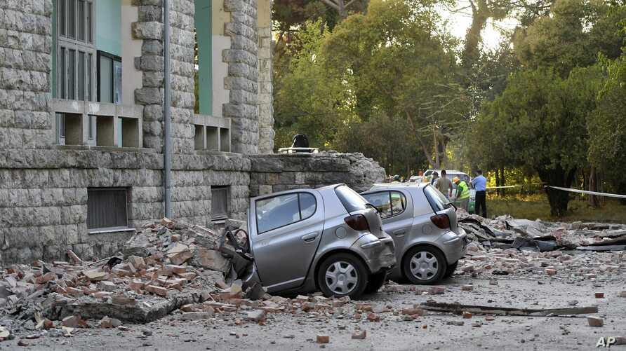 Damaged cars outside the Faculty of Geology building after an earthquake in Tirana, Sept. 21, 2019.