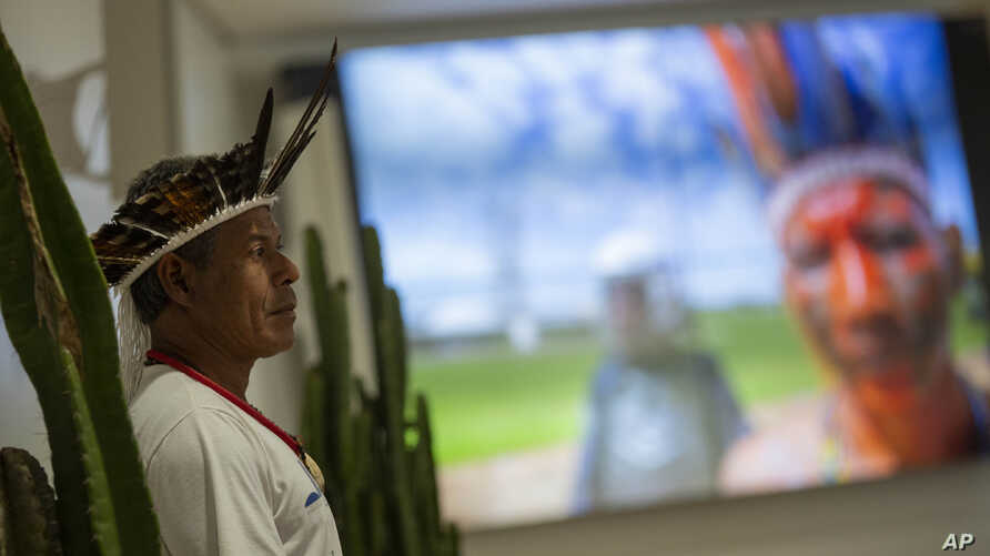 A Pataxo indigenous man attends the launch of the report on violence against indigenous peoples in Brazil, at the headquarters of the National Conference of Bishops in Brasilia, Brazil, Sept. 24, 2019.