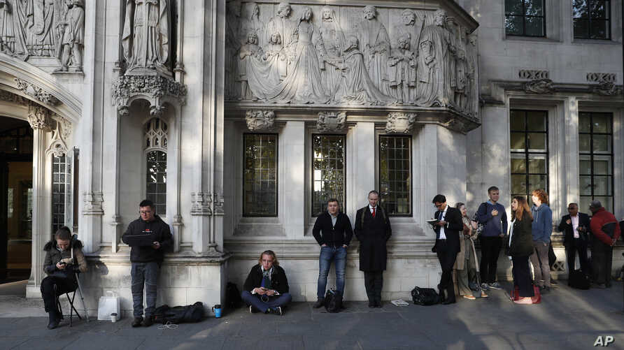 Members of the public queue up for a seat at The Supreme Court in London, Sept. 19, 2019.
