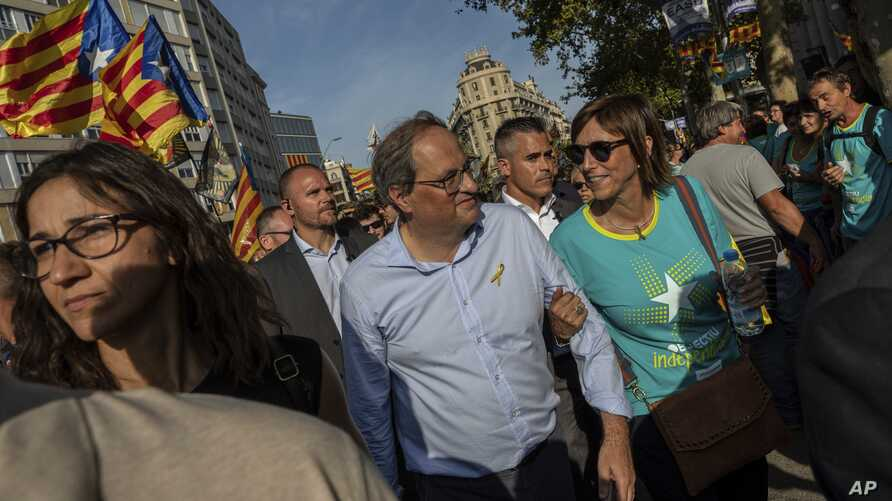 FILE - Catalan regional president Quim Torra, center, is seen during a pro-independence rally in Barcelona, Spain, Sept. 11, 2019.