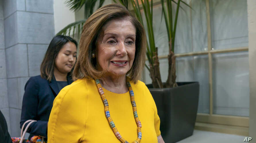 Speaker of the House Nancy Pelosi, D-Calif., arrives for a gathering of the House Democratic Caucus at the Capitol in Washington, Sept. 10, 2019.