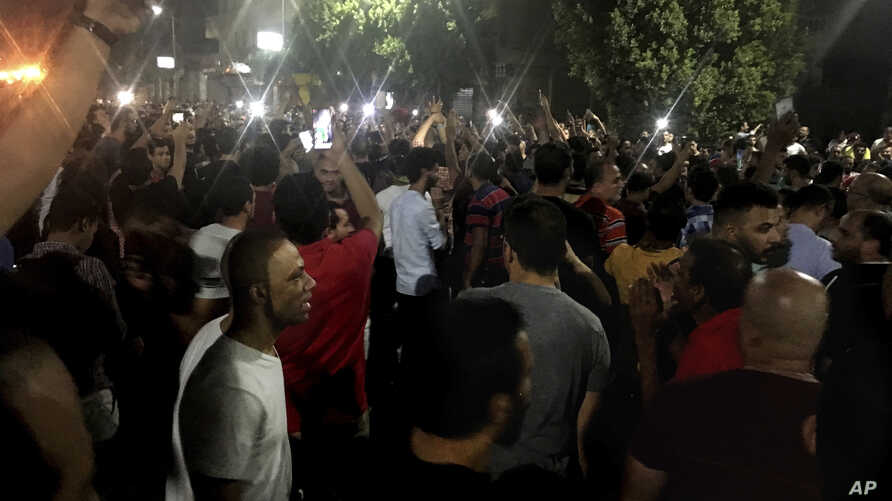 Protesters chant slogans against the regime in Cairo, Egypt, early Saturday, Sept. 21, 2019.