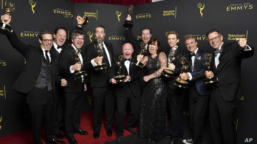 "The team from ""Game of Thrones"" pose with the award for outstanding sound editing for a comedy or drama series for ""The Long Night"" on night two of the 2019 Creative Arts Emmy Awards, Sept. 15, 2019, at the Microsoft Theater in Los Angeles."