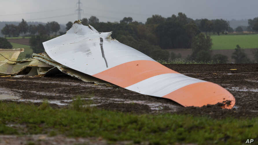 A piece of a wind energy station has crashed down due to heavy storm in Wriedel, Germany, Monday, Sept.30, 2019.