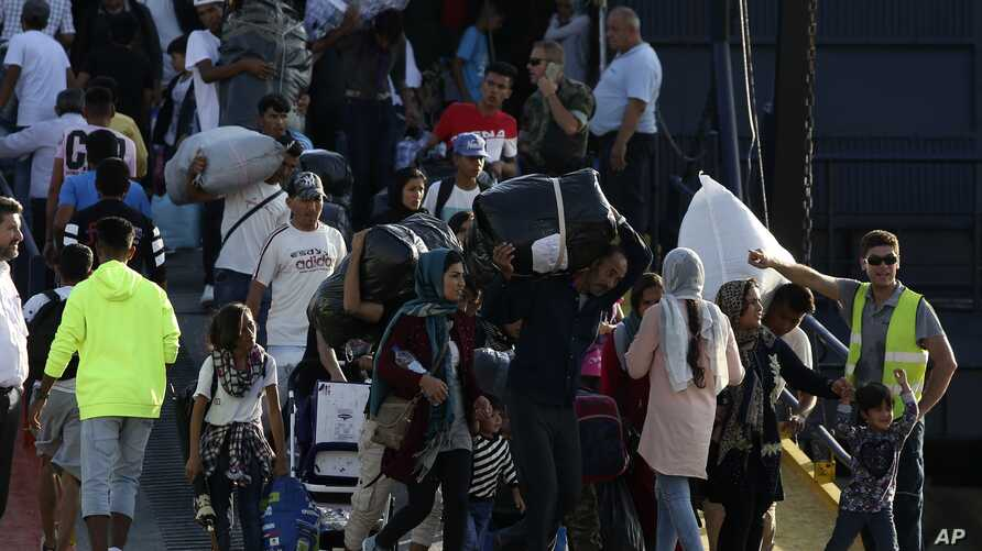 Refugees and migrants arrive at the port of Thessaloniki, northern Greece.