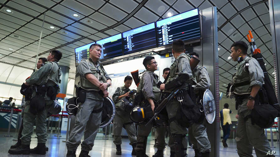 Riot police patrol at the Airport Express central station in downtown Hong Kong, Sept. 7, 2019.