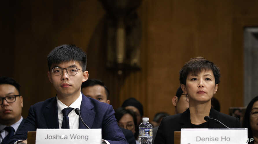 Hong Kong activists Joshua Wong, left, and Denise Ho, attend a congressional hearing about the protests in Hong Kong, Sept. 17, 2019, on Capitol Hill in Washington.