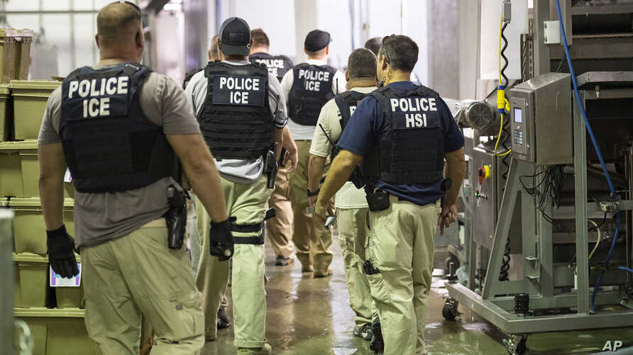 Immigration and Customs Enforcement (ICE) together with Homeland Security Investigations (HSI) officers prepare to make arrests at an agricultural processing facility in Canton, Mississippi, Aug. 7, 2019.