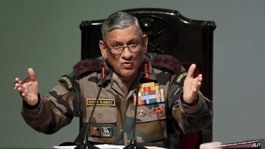 FILE - Indian Army Chief Bipin Rawat speaks during a press conference ahead of Army Day in New Delhi, India, Jan. 12, 2018.
