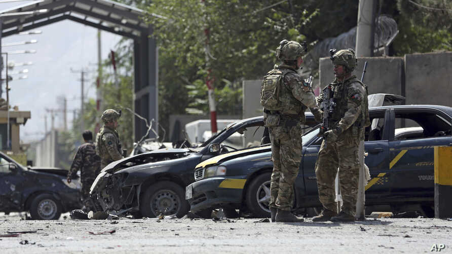 NATO-led Resolute Support forces inspect the site of a car bomb explosion in Kabul, Afghanistan, Sept. 5, 2019.