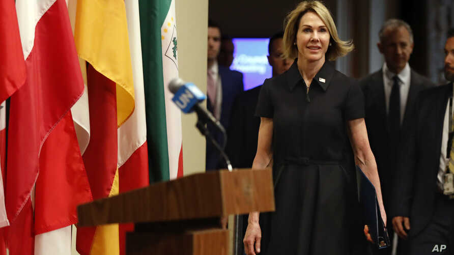 New U.S. Ambassador Kelly Craft walks to the podium to address the press after attending her first Security Council meeting, at United Nations headquarters, in New York, Sept. 12, 2019.