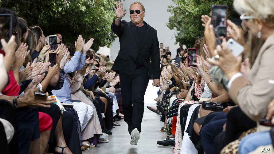 Designer Michael Kors is applauded on the runway after his collection was modeled during Fashion Week in New York, Sept. 11, 2019.