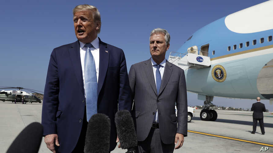 President Donald Trump and Robert O'Brien, just named as the new national security adviser, speak to the media at Los Angeles International Airport, Sept. 18, 2019.