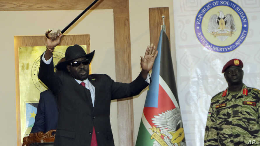 South Sudan President Salva Kiir waves to the delegates attending South Sudan Peace talks in Juba, South Sudan, Sept.9, 2019. Machar returned to meet with President Salva Kiir and held talks in preparation for the formation of a coalition government.