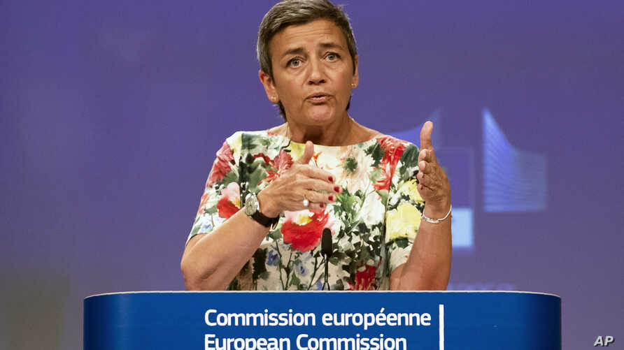 FILE - European Antitrust Commissioner Margrethe Vestager talks during a news conference at the European Commission headquarters in Brussels, Belgium, July 18, 2019.