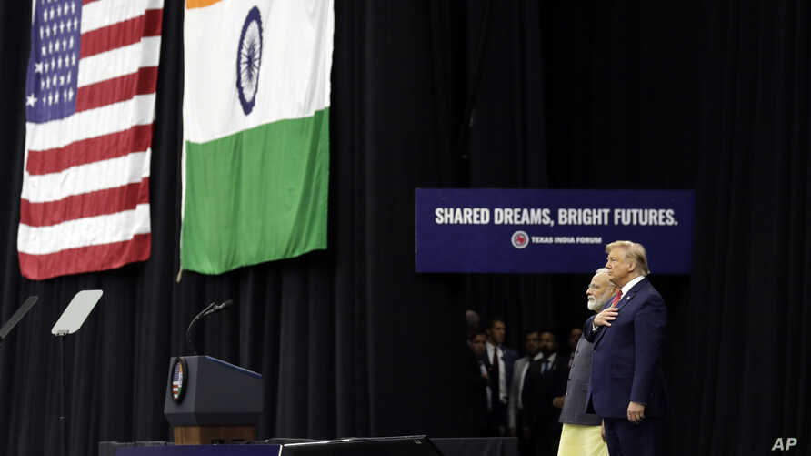 """President Donald Trump stands on stage with Indian Prime Minister Narendra Modi at NRG Stadium, Sept. 22, 2019, in Houston, during a """"Howdy Modi: Shared Dreams, Bright Futures"""" event."""