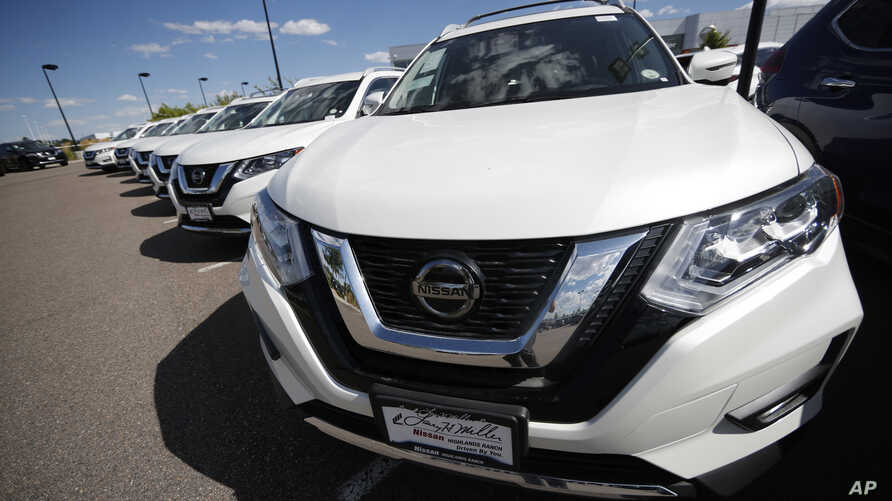Rogue sports utility vehicles sit at a Nissan dealership in Highlands Ranch, Colorado, Aug. 25, 2019.