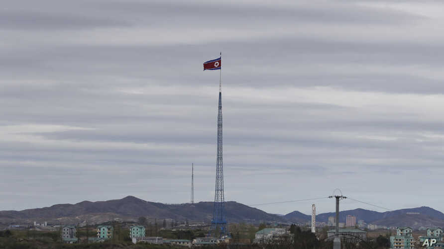 FILE - A North Korean flag flutters in the wind atop a tower in North Korea's village of Gijungdongseen, as seen from the Taesungdong freedom village inside the demilitarized zone in Paju, South Korea, April 27, 2018.