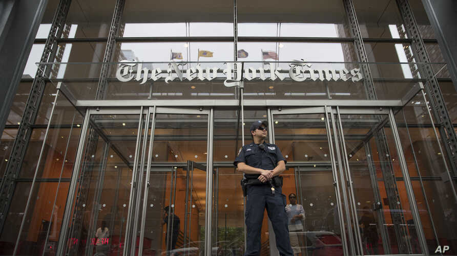 FILE - A police officer stands guard outside The New York Times building in New York, June 28, 2018.