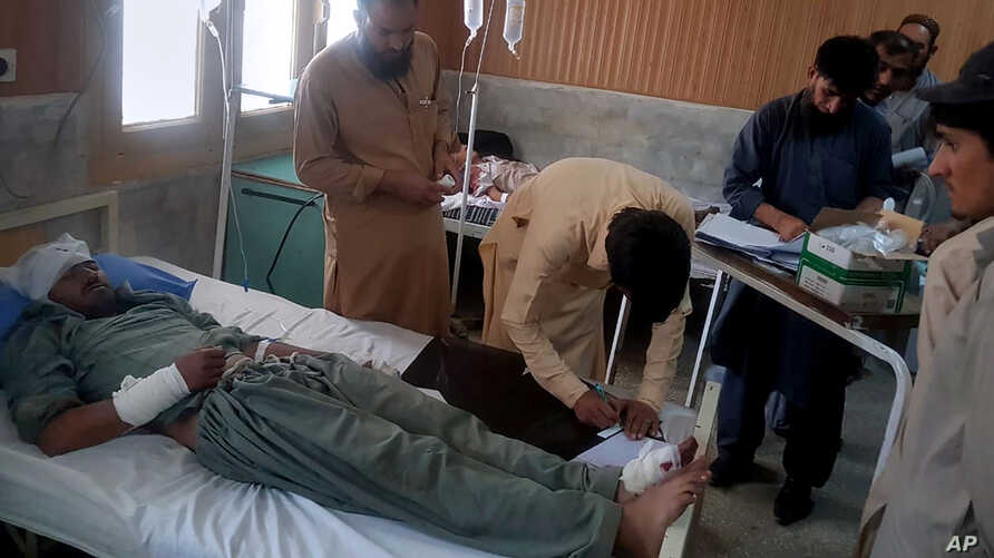 A victim in a bus accident is treated at a hospital in Chilas, northwest Pakistan, Sunday, Sept. 22, 2019.