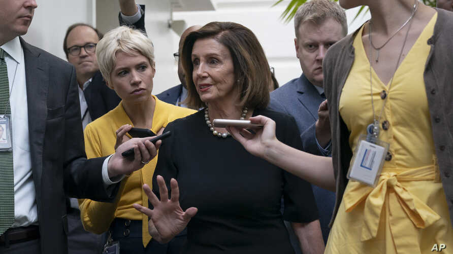 Speaker of the House Nancy Pelosi, D-Calif., is surrounded by reporters as she arrives to meet with her caucus at the Capitol in Washington, after declaring she will launch a formal impeachment inquiry against President Donald Trump.
