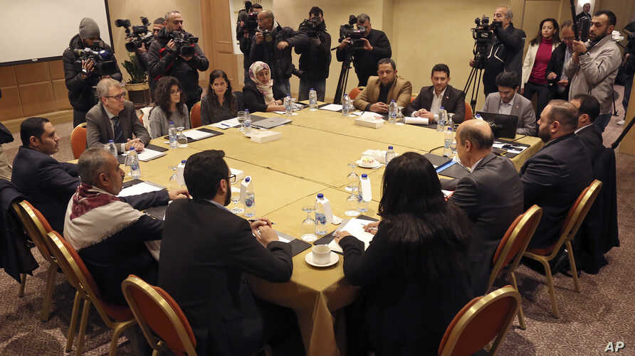 A Houthi rebel delegation and representatives of the internationally recognized Yemeni government meet for talks, in Amman, Jordan, Jan. 17, 2019.