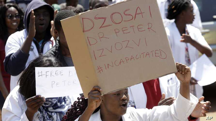 A group of Zimbabwean doctors protest at Parirenyatwa hospital in Harare, Sept. 15, 2019.