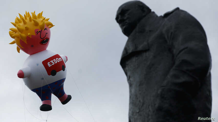 A giant inflatable blimp representing Boris Johnson is flown near a statue of former British Prime Minister Winston Churchill opposite the Houses of Parliament, ahead of an anti-Brexit 'No to Boris, Yes to Europe' protest in London, Britain, July 20,2019.