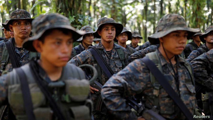 Soldiers stand in formation during a temporary state of siege, approved by the Guatemalan Congress following the death of several soldiers last week, in the community of Semuy II, Izabal province, Guatemala, Sept. 9, 2019.