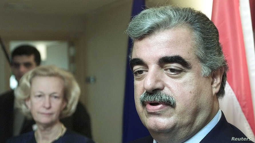 FILE - Lebanese Prime Minister Rafiq Hariri (R) answers reporters' questions during a joint press conference with European Parliament President Nicole Fontaine after their meeting in Brussels, Jan. 10, 2002.