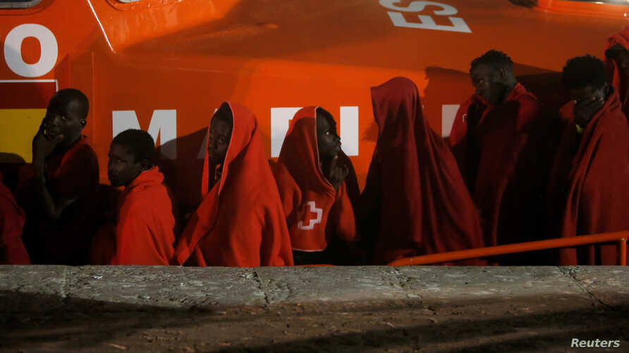 Migrants, intercepted off the coast in the Mediterranean Sea, disembark from a rescue boat at the port of Malaga, southern Spain, Sept. 2, 2019.