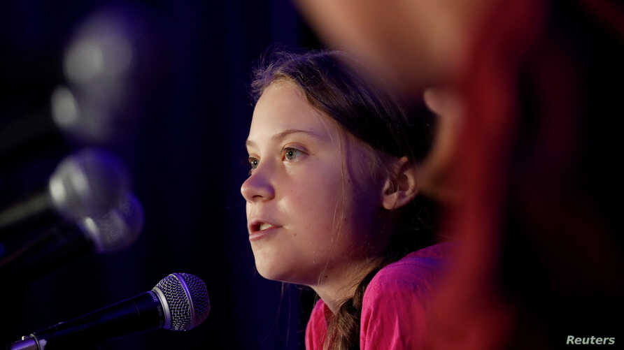 Swedish climate activist Greta Thunberg speaks with other child petitioners from 12 countries who presented a landmark complaint to protest the lack of government action on the climate crisis during a press conference in New York, Sept. 23, 2019